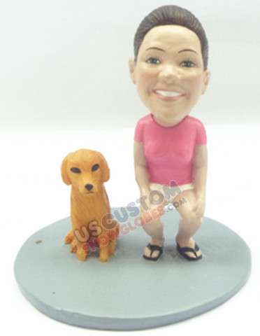 Female crouched down standing next to her dog personalized snow globe