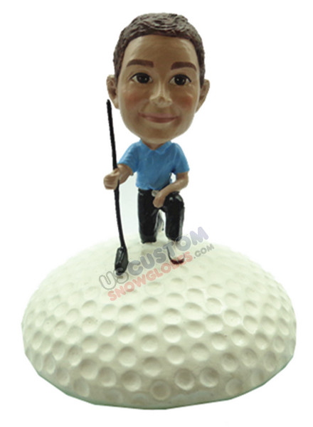 Male golfer on one knee with golf ball base personalized snow globe
