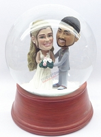 Male and female wedding couple snow globe