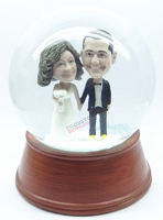 Male and female wedding couple snow globe 2