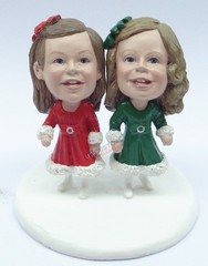 couple of girls wearing dresses couple snow globe