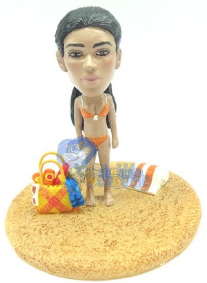 Female in bikini personalized snow globe