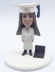 Female graduation doll with a laptop on the floor personalized snow globe