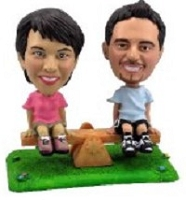 See Saw on grass couple custom bobble head doll