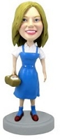 Girl with picnic bobble head doll