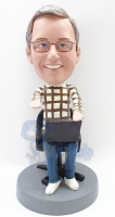 Male sitting with computer custom bobble head doll figurine