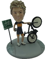 Female on bike trail custom bobble head doll Premium