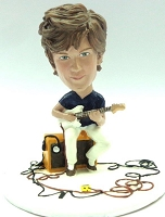 Male playing his guitar sitting on his amp custom bobble head doll Premium