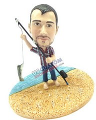 Male fisherman standing at the shoreline custom bobble head doll Premium
