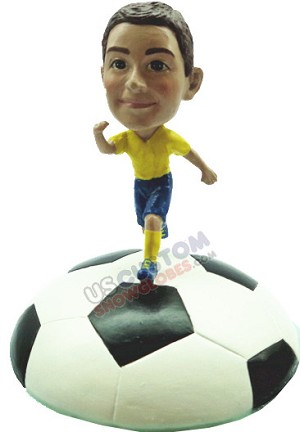 Male soccer player standing on soccer ball base personalized snow globe
