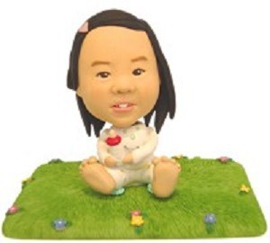 Baby Sitting on lawn custom bobble head doll