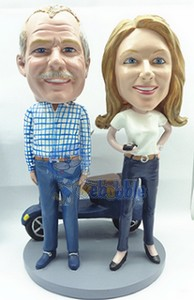 couple with a Vespa custom bobble head doll