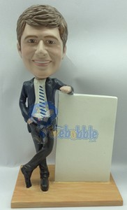 executive in suit, leaning on a sign custom bobblehead